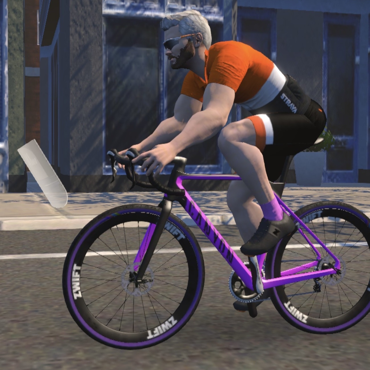 Avatar in the virtual cycling training app zwift on a pink Canyon Inflite CF bike.