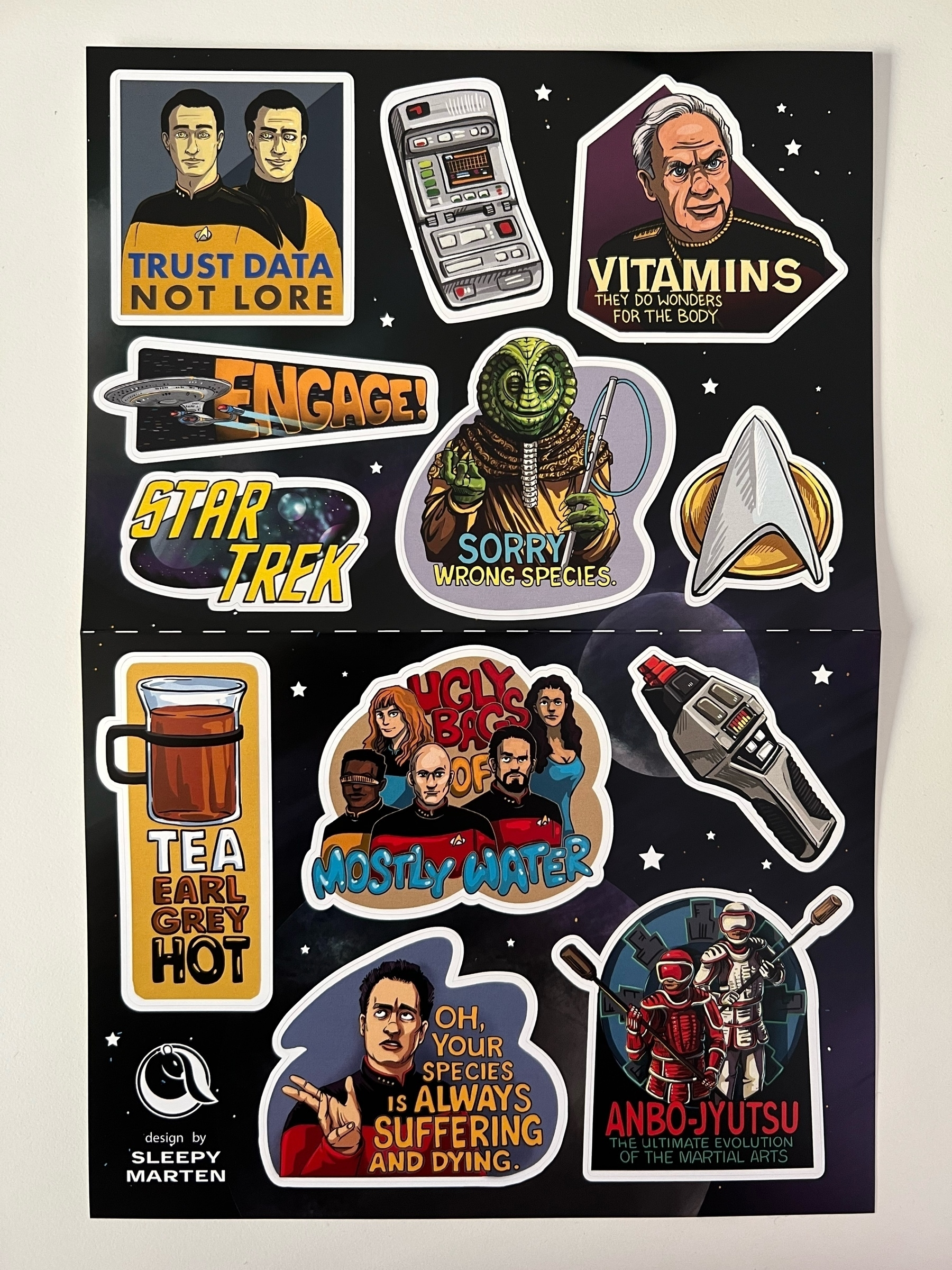 Sheet with a number of Star Trek-themed stickers based on fan art designs by the Etsy seller Sleepy Marten.